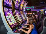 View larger image of People playing on the slots at COUSHATTA LUXURY RV RESORT AT RED SHOES PARK image #1