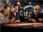 View larger image of Three people playing blackjack at COUSHATTA LUXURY RV RESORT AT RED SHOES PARK image #2
