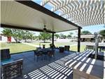 View larger image of Patio area with picnic table at A COUNTRY RV PARK image #8
