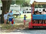 View larger image of Kids on a wagon ride at YOGI BEAR JELLYSTONE CAMP RESORTS image #9