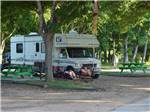View larger image of Couple camping in RV at COLORADO LANDING RV PARK image #8
