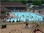 View larger image of People swimming in the pool at CROSS CREEK CAMPING RESORT image #1