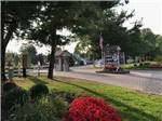 View larger image of Flower bed with a wood barrel at CROSS CREEK CAMPING RESORT image #5