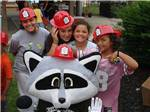 View larger image of Raccoon mascot with kids in fireman helmets at CROSS CREEK CAMPING RESORT image #8