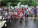 View larger image of Group of kids on bicycles at CROSS CREEK CAMPING RESORT image #11
