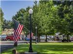 View larger image of USA flags hanging from light poles at RISING RIVER RV PARK image #4