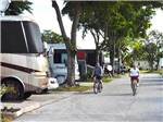 View larger image of Men riding bikes at SUNSHINE HOLIDAY FT LAUDERDALE image #5