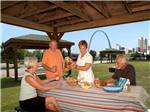 View larger image of An elderly couple sitting in the doorway of their motorhome at CASINO QUEEN RV PARK image #1