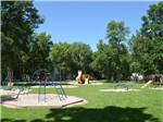 View larger image of Playground with swing set and blue monkey bars at MILLERS CAMPING RESORT image #2