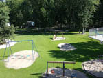 View larger image of Playground with swing set at MILLERS CAMPING RESORT image #7