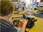 View larger image of Women sewing at CANYON VISTAS RV RESORT image #7