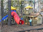 View larger image of Girl at playground at LAKE PINES RV PARK  CAMPGROUND image #8