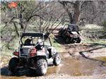 View larger image of Off roaders in a stream at BUTTERFIELD RV RESORT  OBSERVATORY image #3