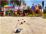 View larger image of Campers playing bocce ball at WHISPER CREEK RV RESORT image #2