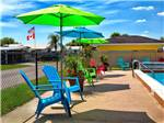 View larger image of Swimming pool with outdoor seating at WHISPER CREEK RV RESORT image #3