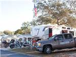 View larger image of Campers with motorcycles and trailer at ORANGE CITY RV RESORT image #3