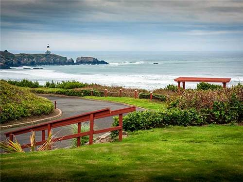 At the other end of the resort, a paved path leads to to the beach & views of the Yaquina Head Light