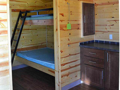 Our Rustic Cabins sleep 4 to 6 people