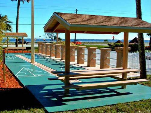 At Camelot,  you can play a game of Shuffleboard while enjoying a view of the Indian River Lagoon.