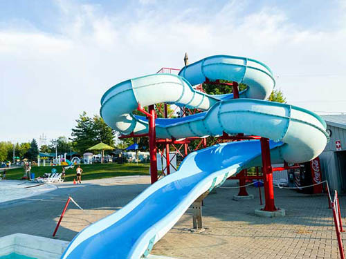 Room for everyone in our one acre pool and enjoy our waterslide