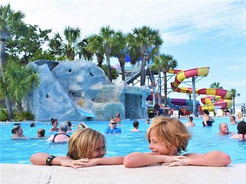 Fun on the slides in our tropical landscape pool