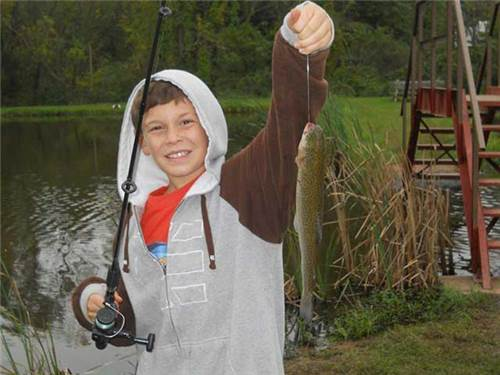 Hey Mom and Dad! Look what I caught in the pond