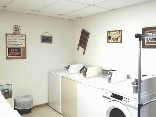 Washers & dryers, and laundry detergent sold in the office, ready to handle your vacation laundry!