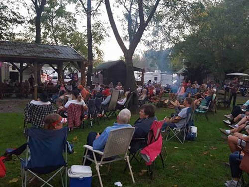 Park guests enjoying a free concert in the park.