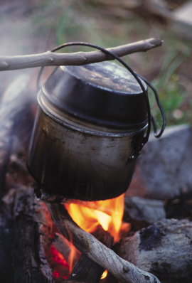 pot cooking over campfire