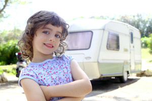 little girl and travel trailer